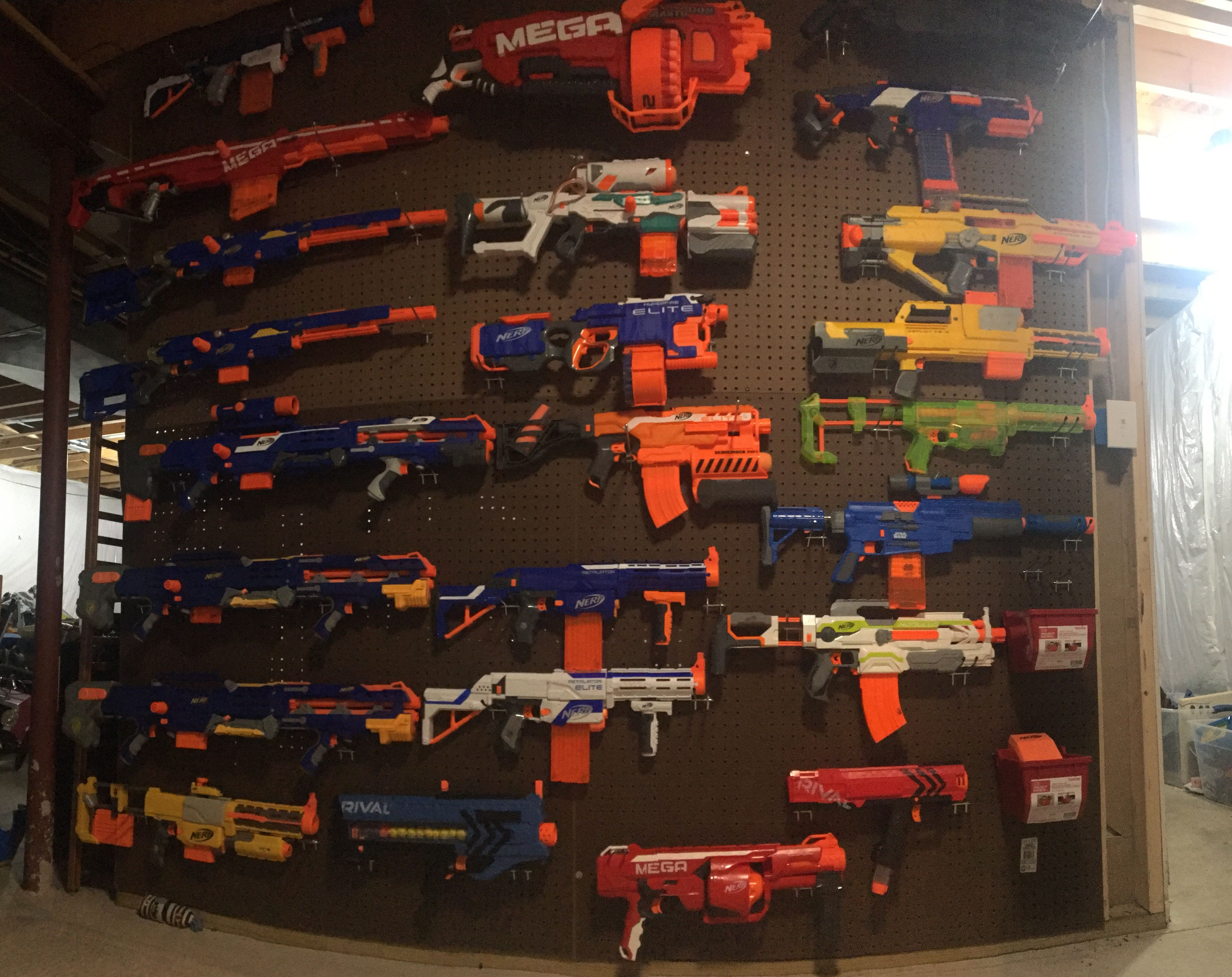 My DIY nerf gun wall. Peg board from Home Depot and pegs from Home ...