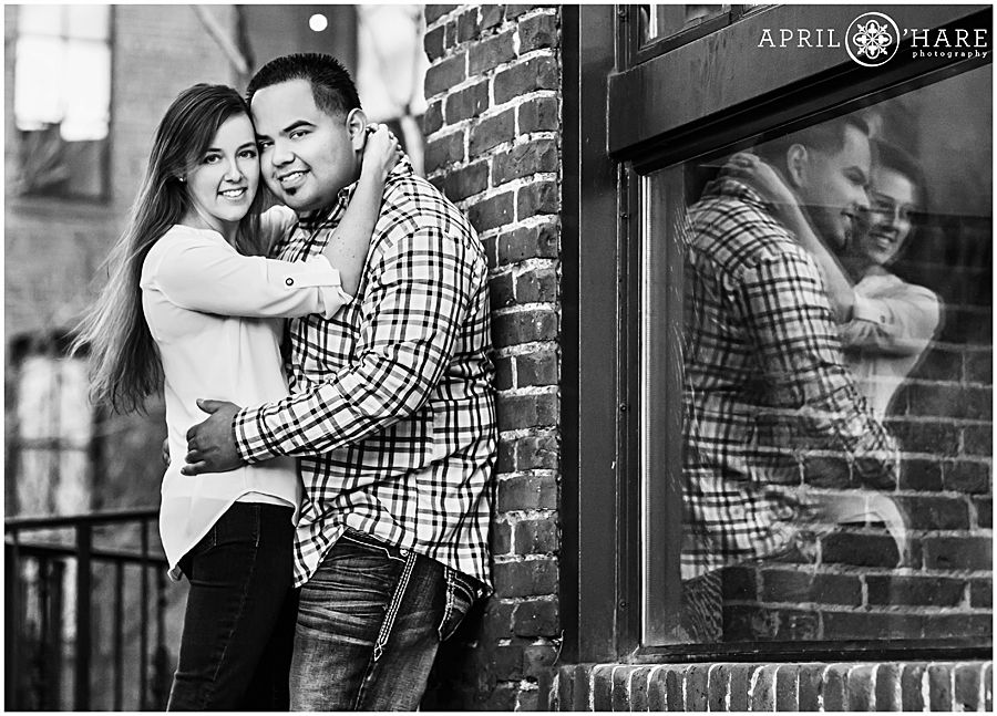 A nice urban engagement photo utilizing a reflection in the Lodo neighborhood of Downtown Denver, Colorado. - April O'Hare Photography http://www.apriloharephotography.com  #DenverEngagement #WinterinDenver #urbanengagement #urbanphotos #DenverUrbanPhotos #lododenver #downtowndenver #denverphotographer