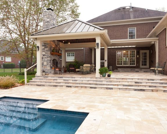 Covered Open Air Porch With Outdoor Fireplace In Nashville