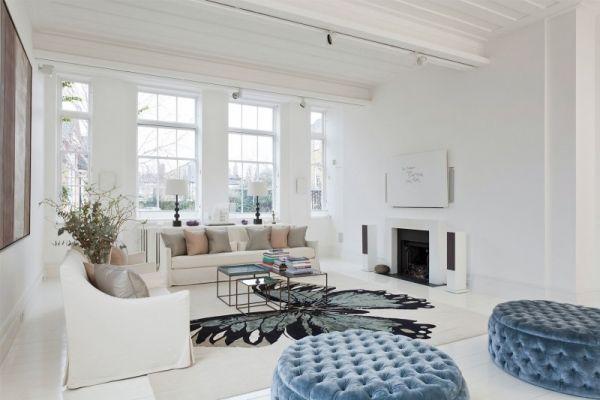 luxus wohnung london samt gesteppte poufs blau