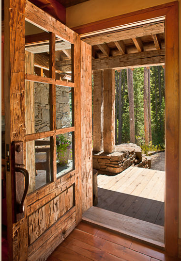 Reclaimed wood custom built door to the log home in Big Sky, Montana.  Look at the ax marks on the wood!  Gorgeous, rustic, and obviously a heavy door!