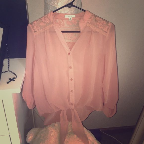 Button down shirt! Great condition. Flower pattern in the back. Tops Button Down Shirts