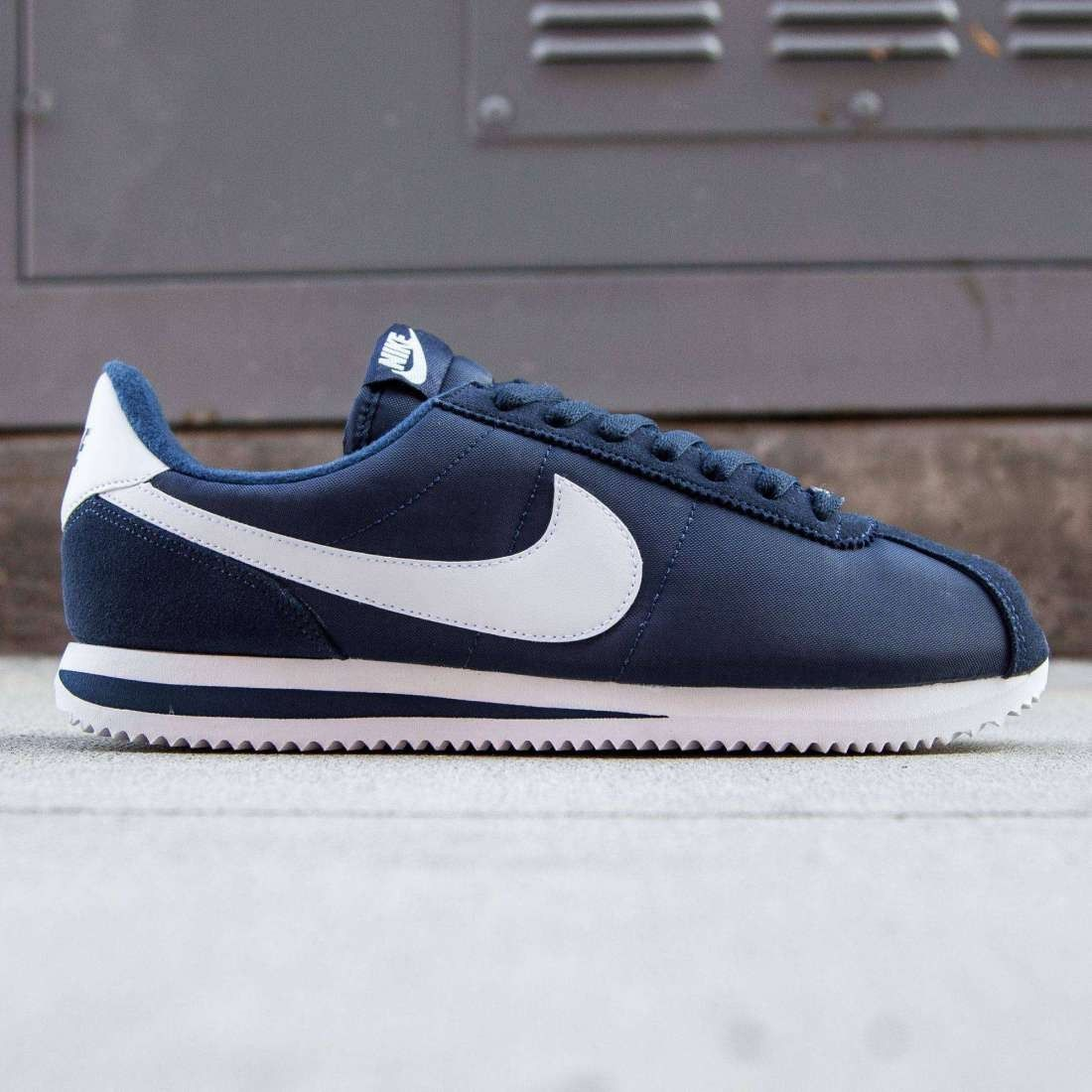 nike cortez navy blue and white