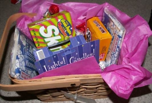Movie Basket Filled With Gifts For A Baby Shower Hostess Good To