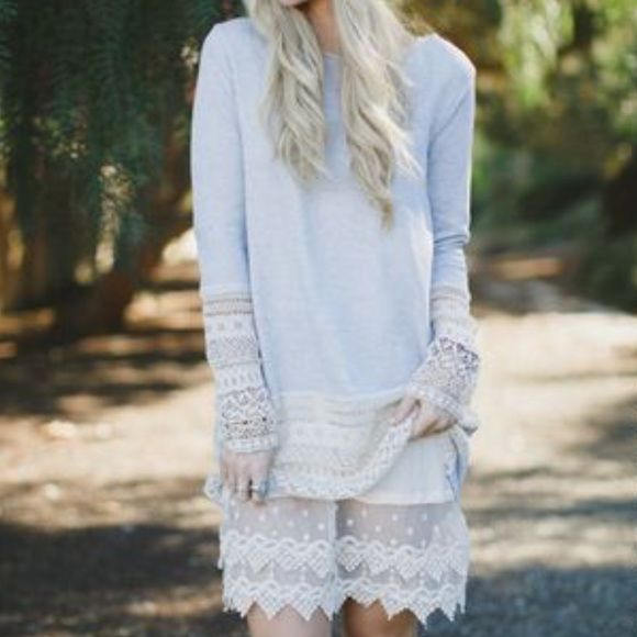 Ivory Lace Slip/Shirt Extender Ivory lace slip/shirt extender with adjustable straps is perfect for layering. May be layered, dressed up or down, or worn alone... Any way you wear it, you'll breathe new life into your wardrobe with this sweet little layering piece. Available in Small & Large Tops Tank Tops
