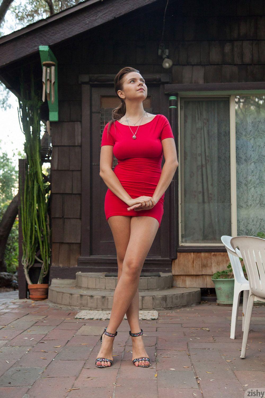 marina visconti in a tight and short red mini dress, looking hot