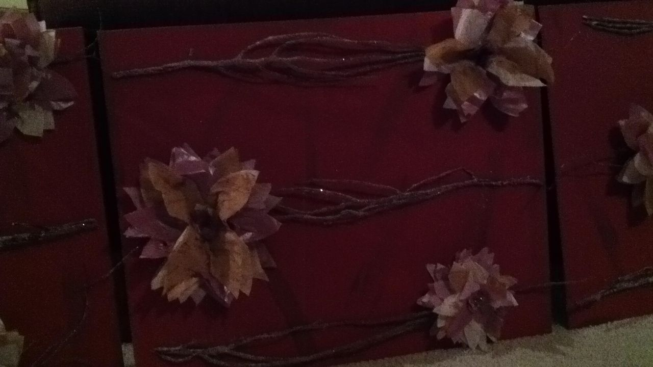 Canvas wall art. Sparkle tree branches and tissue paper flowers.