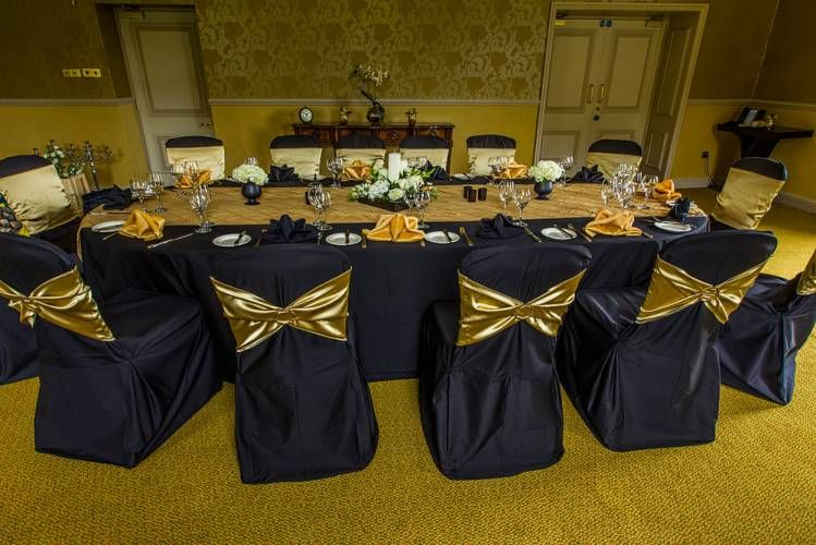 Gold Chair Covers With Black Sash Dark Blue Add A Bow To The For More Style And Elegance