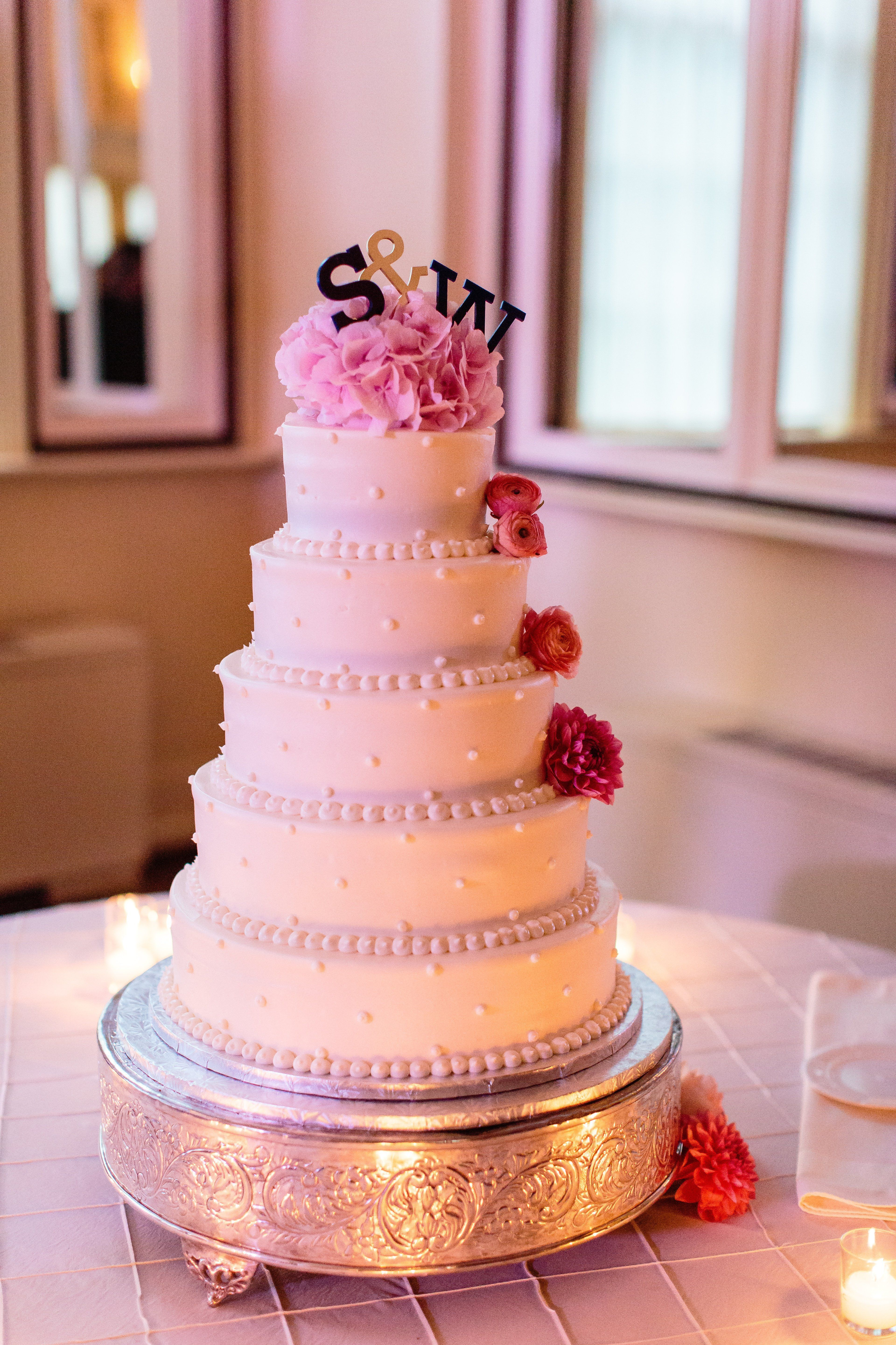 Tiered wedding cake with flowers and initials | Wedding Cakes ...