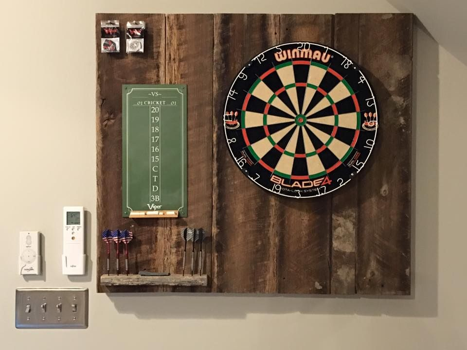 Reclaimed wood makes the perfect backing for a dart board in this Ketron Custom Builders project. http://goo.gl/0uNkE2