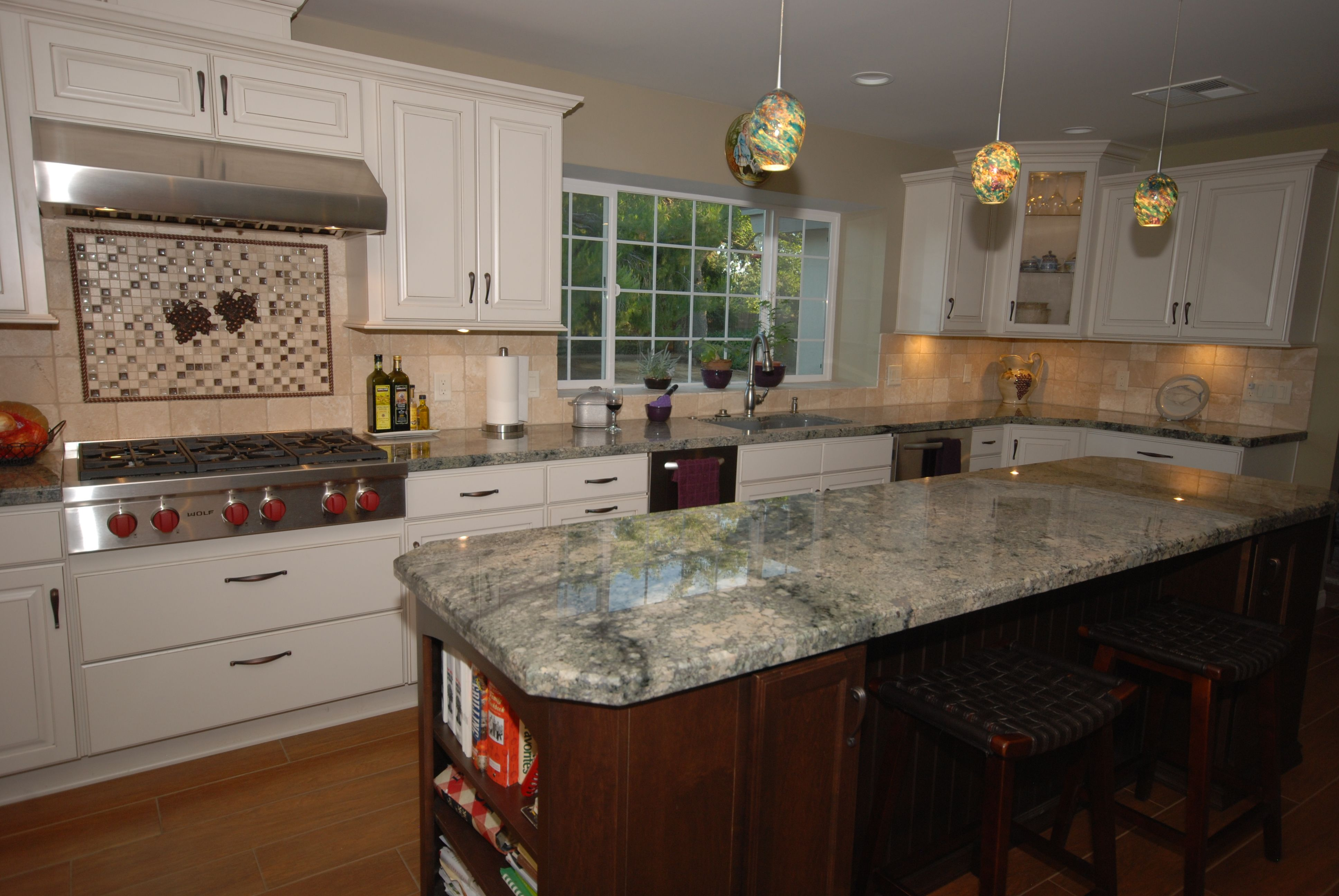 Starmark Maple Macadamia With Chocolate Glaze And Mocha Island Delirium Granite Wolf Cooktop And Vent Kitchen Cabinets In Bathroom Off White Kitchens Kitchen