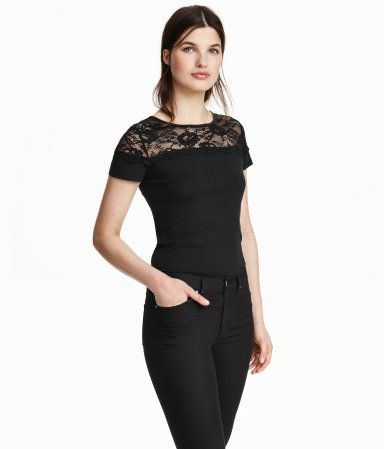 ff3f533c5b40 Fitted top in jersey with a lace yoke and short sleeves. - H M  10 ...