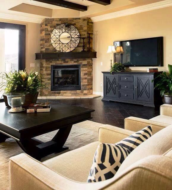 Rustic Modern Living Room With Espresso Dark Wood Floors Rock Fireplace Beamed Ceiling Transitional Furniture Looks Almost Lik Home Home Staging Home Decor