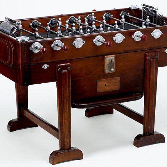 The 50s era foosball table with rubber playing surface for Table design latex