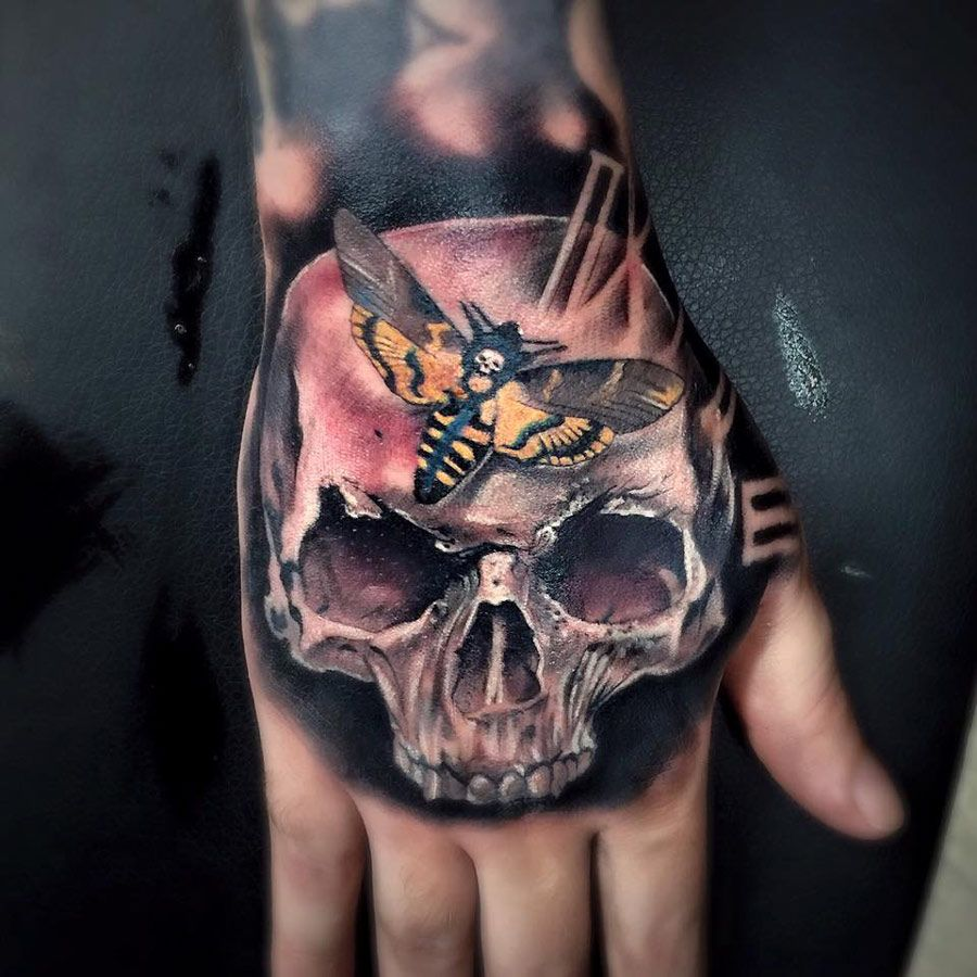 Face tattoos designs and ideas page 7 - Awesome Hand Tattoo With A Skull Death S Head Hawkmoth And A Clock Face