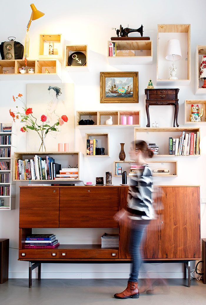 Wall with a mix of shelves, cabinets and frames. Vintage look mixed ...