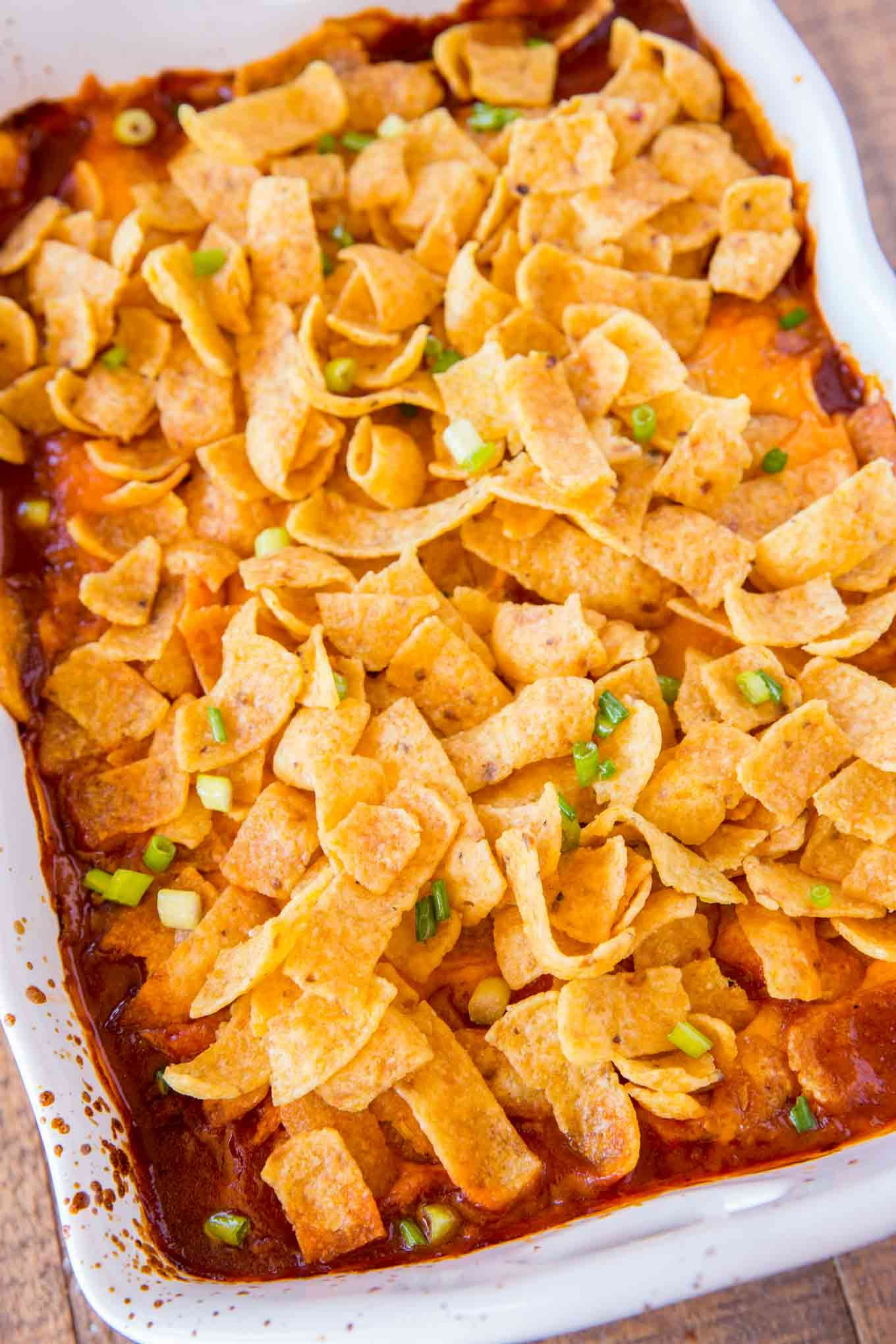 Cheesy Crunchy Frito Pie With Ground Beef Ranch Style Beans Cheese And Enchilada Sauce Baked With Crispy Fritos Frito Pie Ground Beef Recipes Mexican Recipes