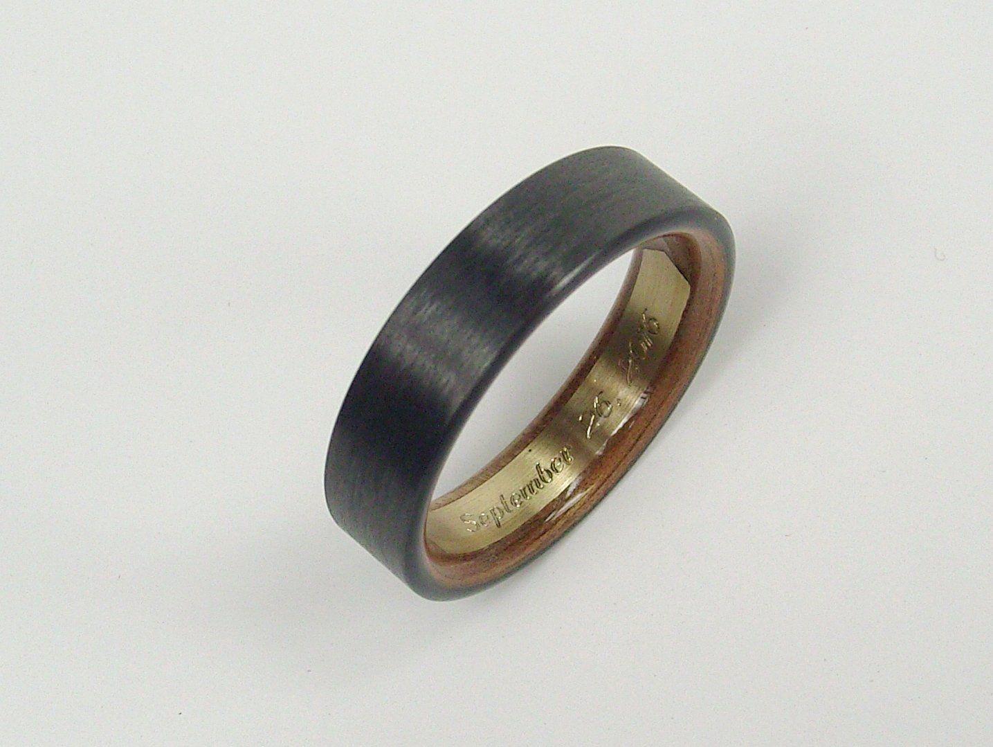 Black carbon fiber ring with a hawaiian koa wood interior featuring