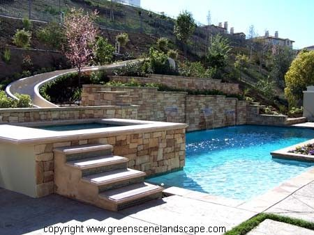 50 Waterslide Into Linear Pool And Adjacent Raised Spa