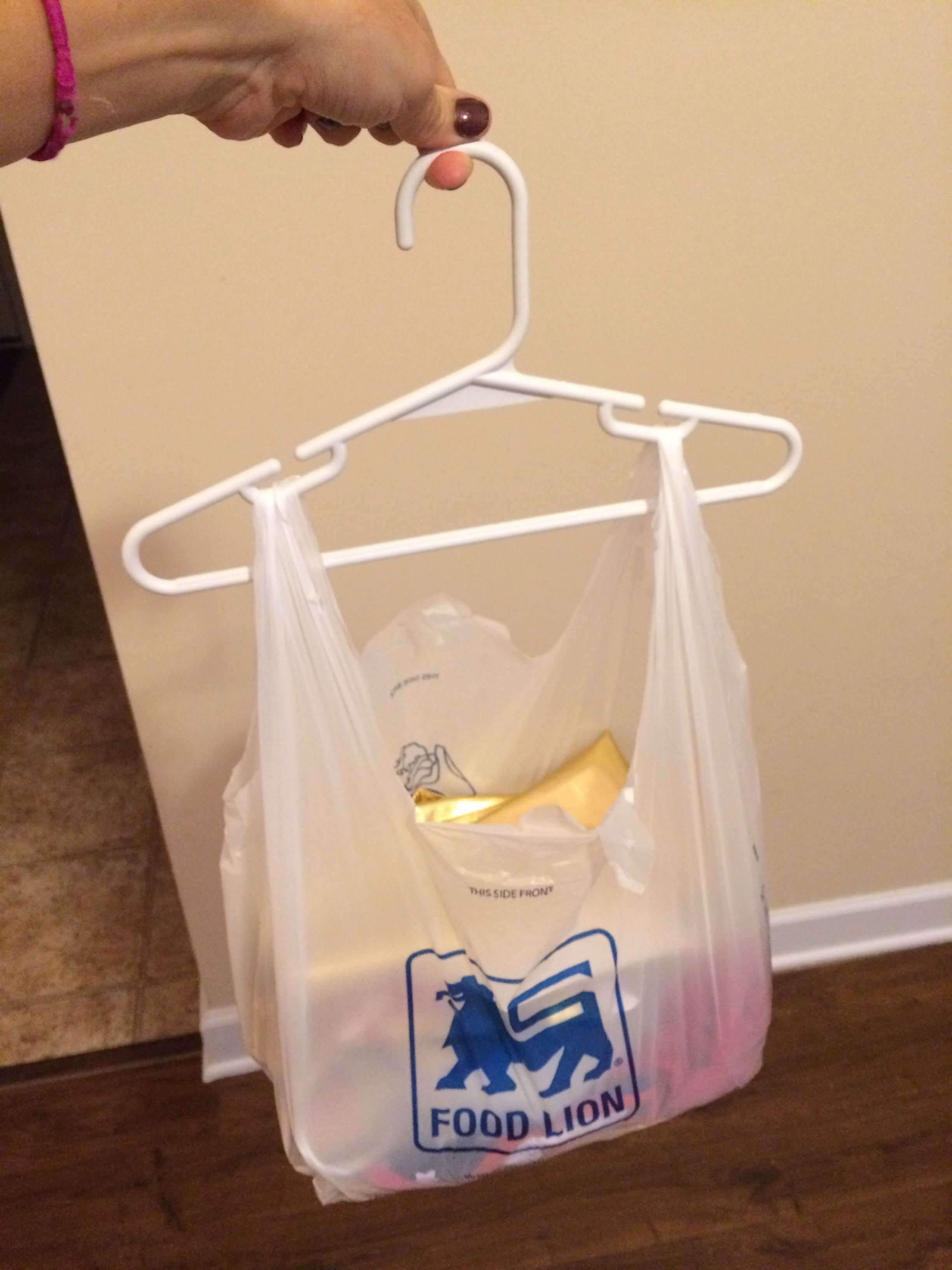 Craft projects stored in a plastic bag on a hanger ...
