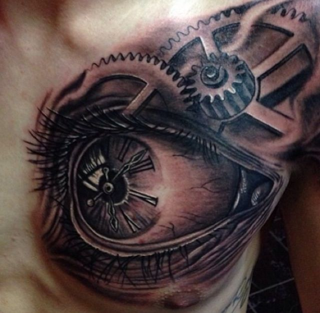 Chest tattoo. The eye and gears mix is pretty nice.
