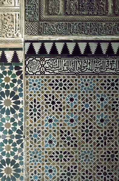 Image SPA 1018 featuring decorated area from the Alhambra, in Granada, Spain, showing Geometric Pattern and Calligraphy using ceramic tiles, mosaic or pottery and stucco or plasterwork.