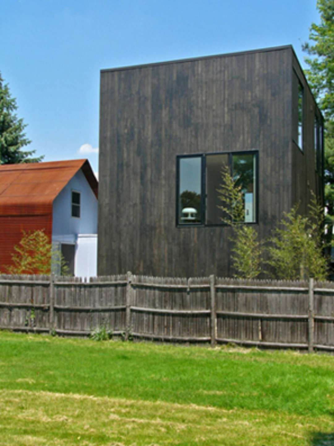 Medium Black Box With Vertical Red Cedar Tongue And Groove Cladding Contrast With Small House A K Architecture House Exterior Tongue And Groove Cladding