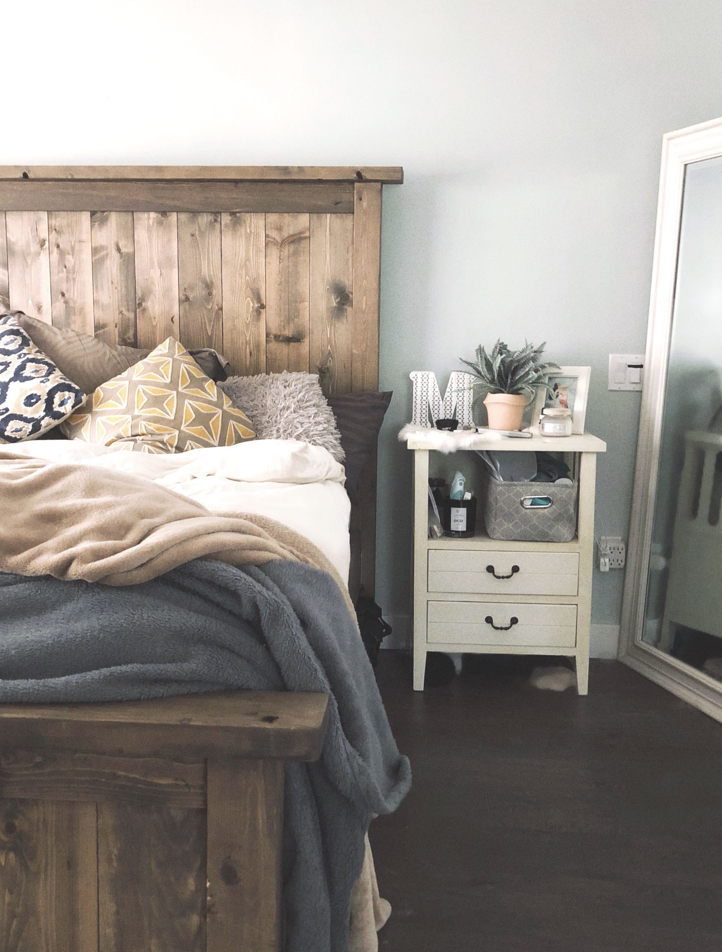 coastal inspired bedroom featuring farmhouse style bed and