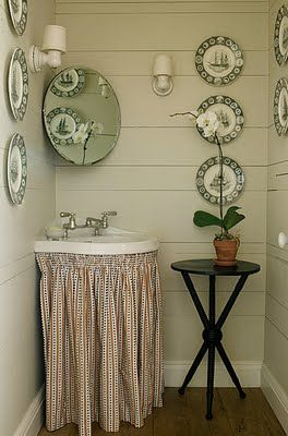 Green transferware on painted stacked boards gives a vintage feel.