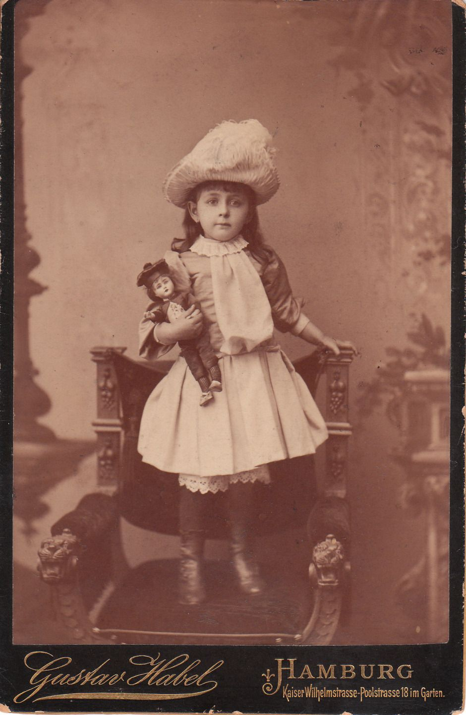 Little Victorian girl with her little boy doll