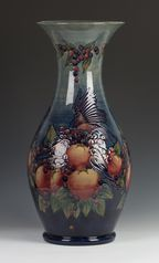 A large Moorcroft pottery baluster vase, designed by Sally Tuffin, circa 1990, decorated with Finch design, impressed factory marks, painted signature of William John Moorcroft, 'S.T. Des' and dated '9-3-1990' to base