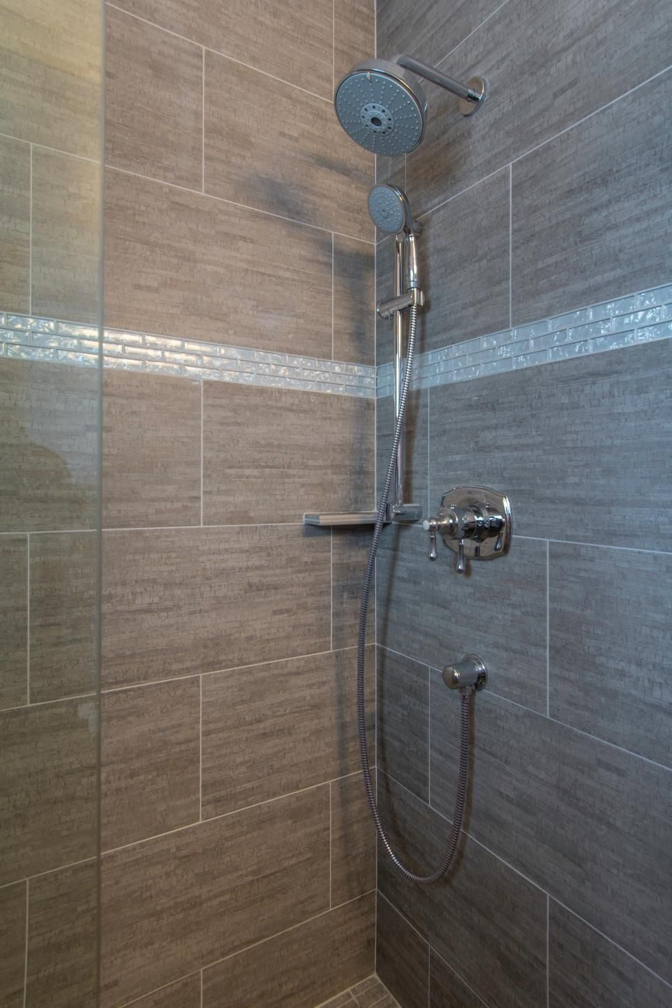 The gray tiled shower stall brings added color, texture and visual ...