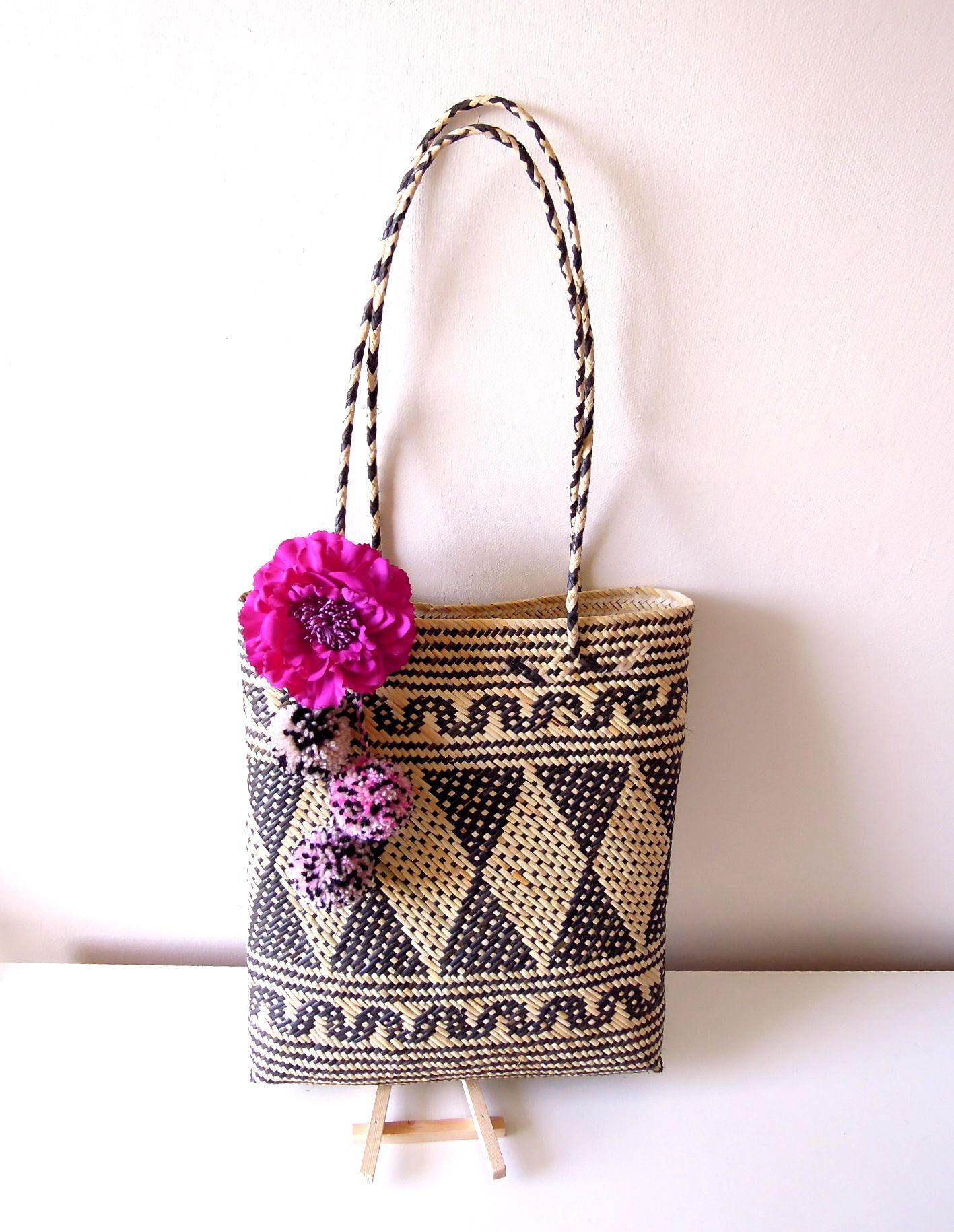Handwoven rattan bag with pom poms and fabric flower – Boho tribal beach bag  – Ethnic tribal Borneo bag - Rattan beach bag by BrightonBabe on Etsy b988f63a6b545