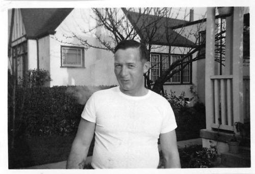 Photograph Snapshot Vintage Black and White: Man Smirk Smile Yard 1950's