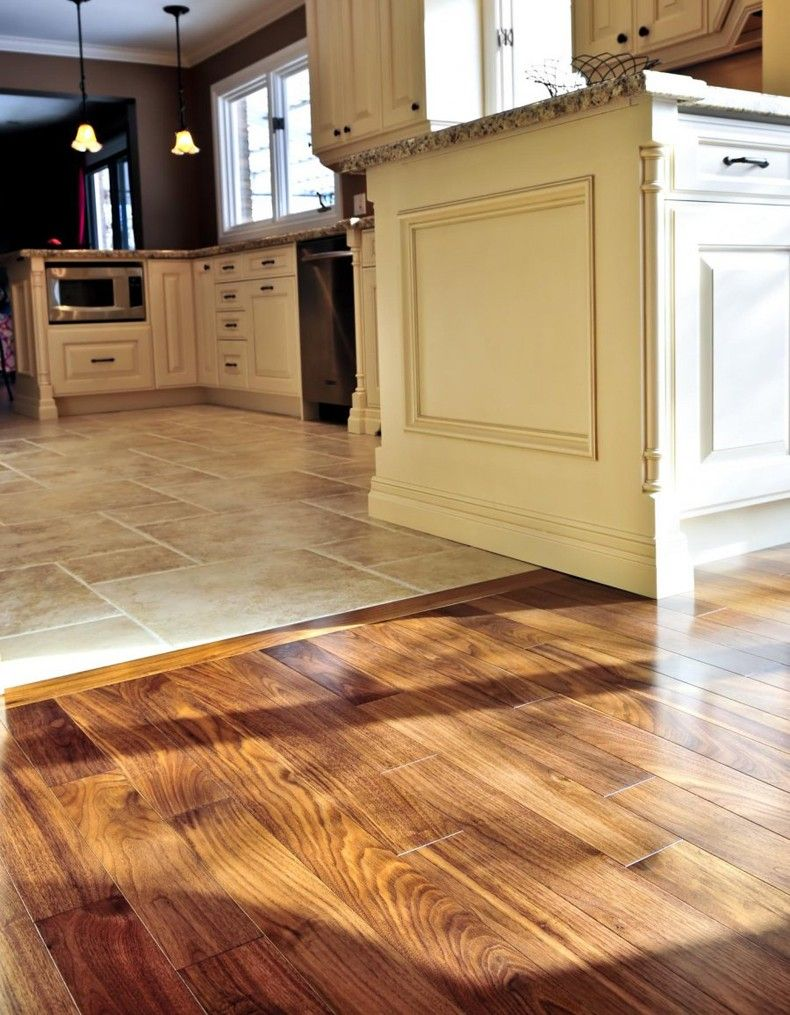 Perfectly smooth transition from hardwood flooring to tile for Kitchen flooring installation