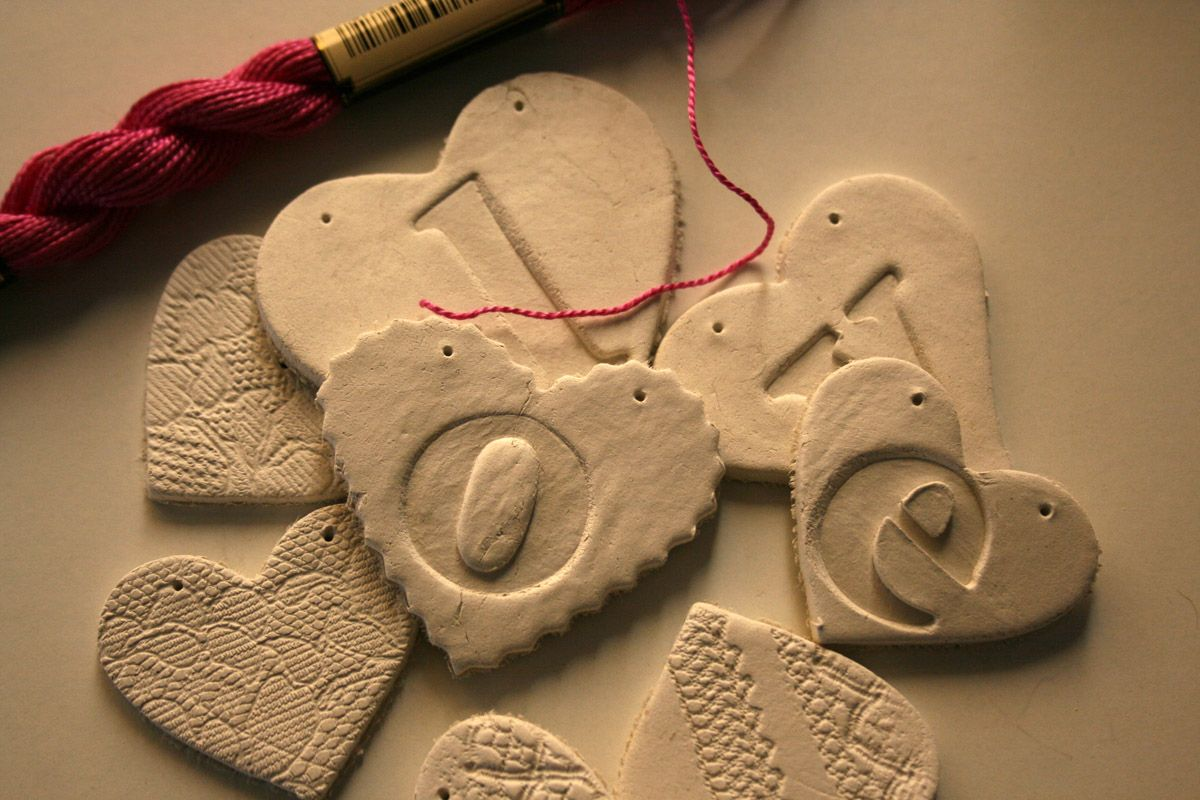 White clay, cardboard letters and lots of LOVE.