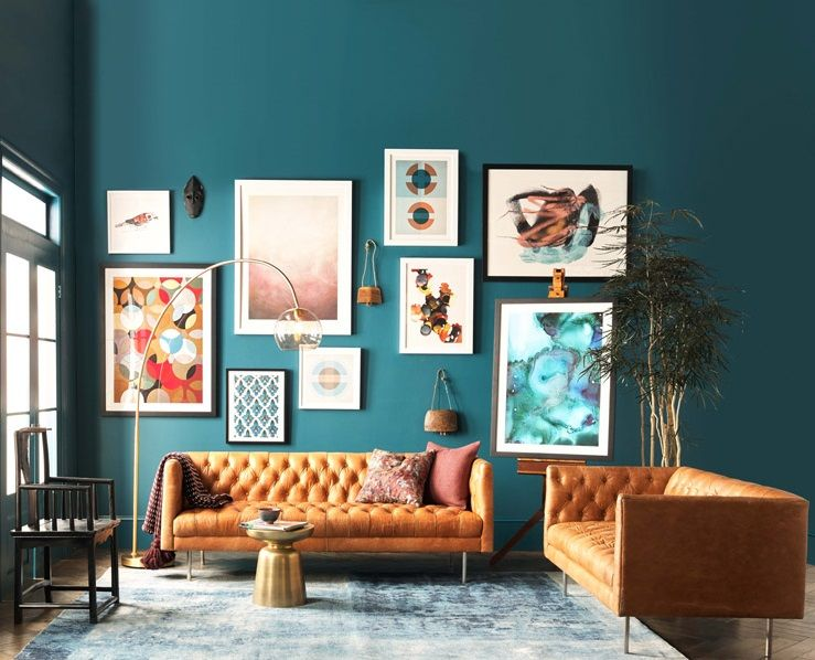 An Artful Living Room The Style Modern Chesterfield Sofa Golden Side Table Floor Lamp Blue Rug Prints L R Colorful Retro Print Small