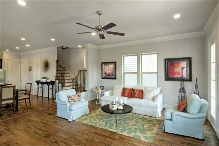 Spacious Living Room With 10 Ft Ceilings Recessed Can Lighting Ceiling Fan 4 Speakers For