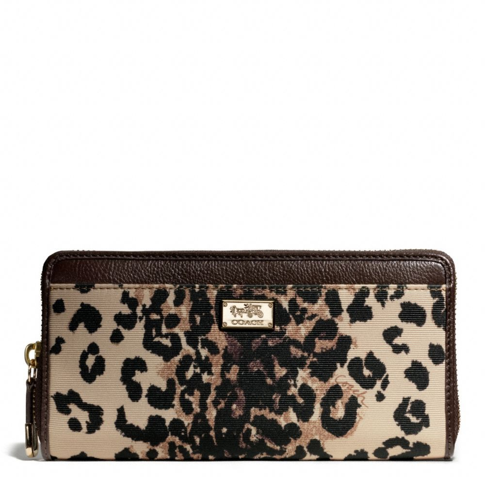 The Madison Accordion Zip Wallet In Ocelot Print Fabric from Coach.  Yessssssss