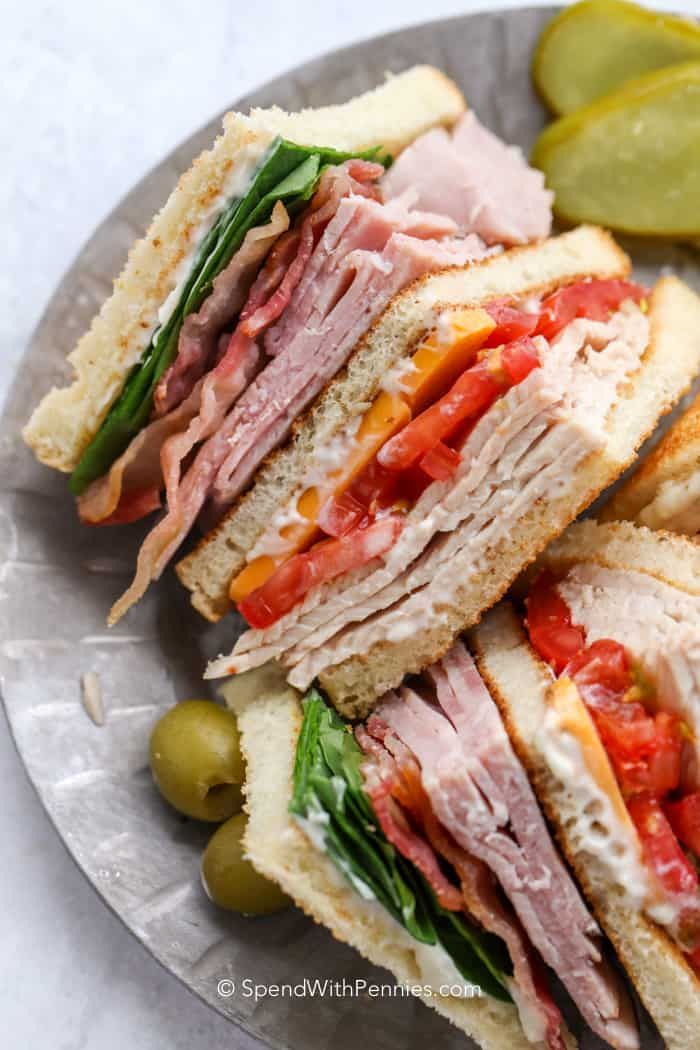 30 Tasty Summer Sandwiches Perfect for Your Next Picnic My family loves this club sandwich recipe! With layers upon layers of chicken, turkey, ham, bacon, cheese, lettuce and tomatoes we can't get enough!