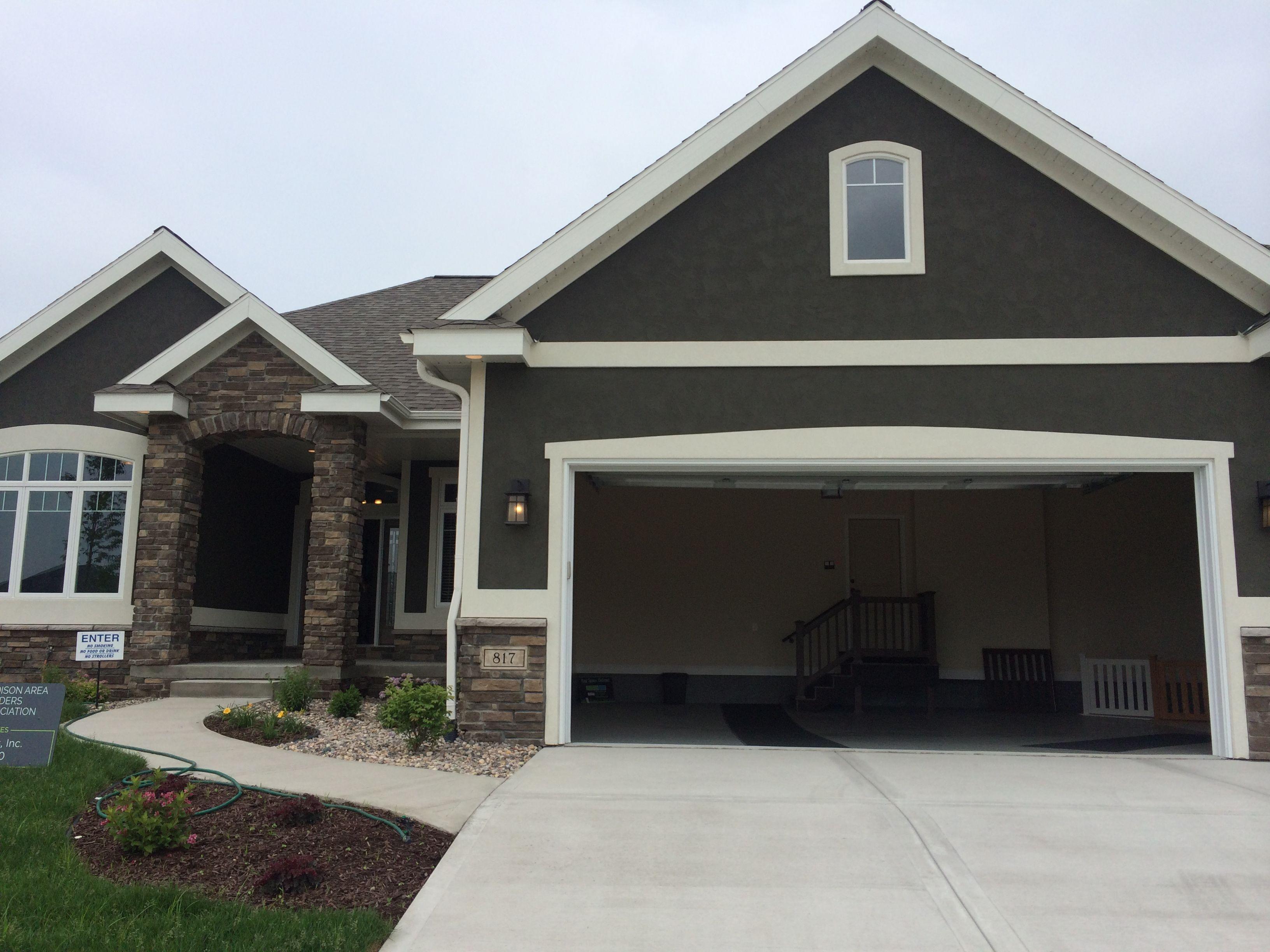 dark grey stucco exterior, white trim, nice stone entrance ...