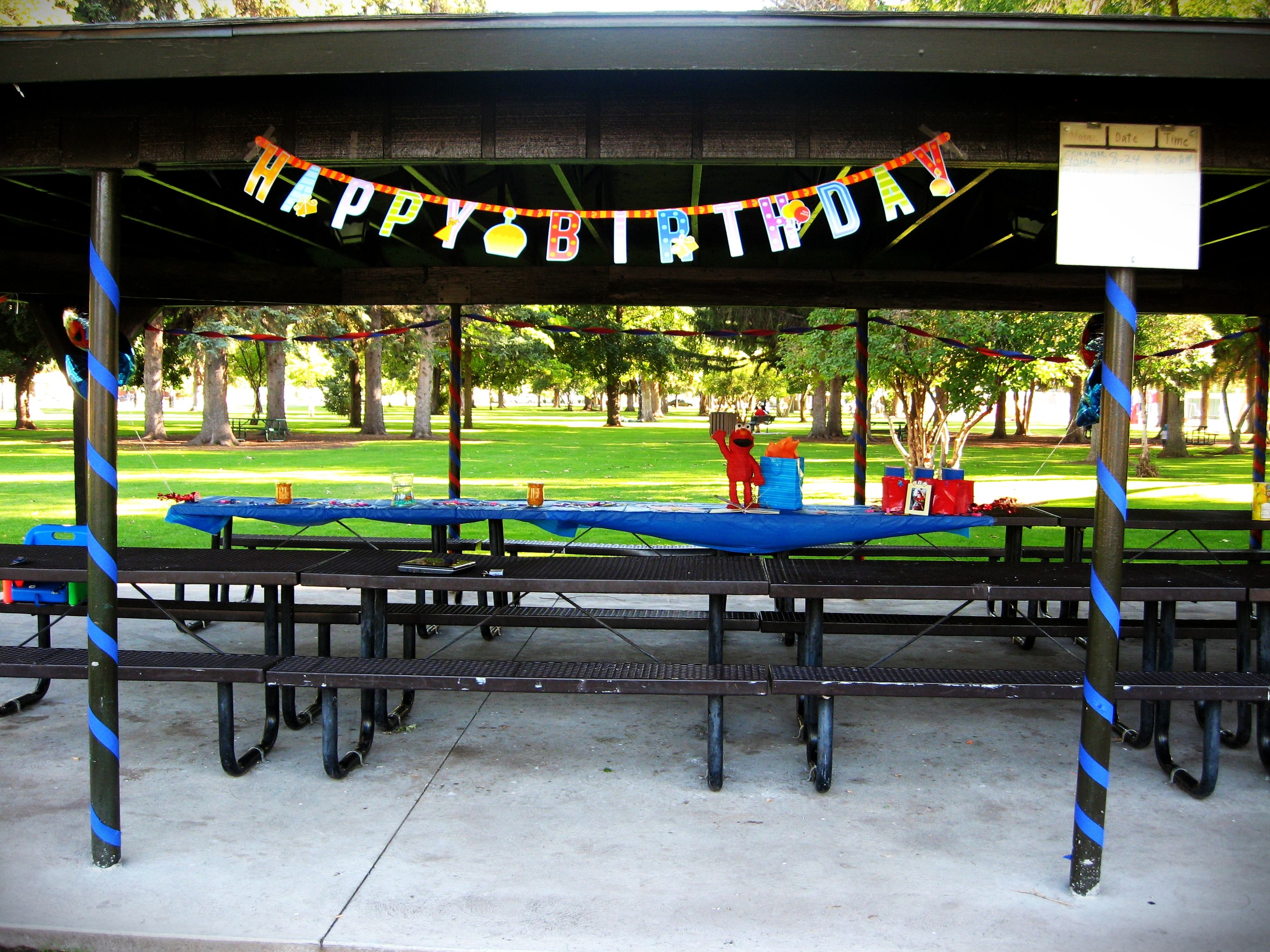 Outdoor party at a park pavilion decorated using streamers banner