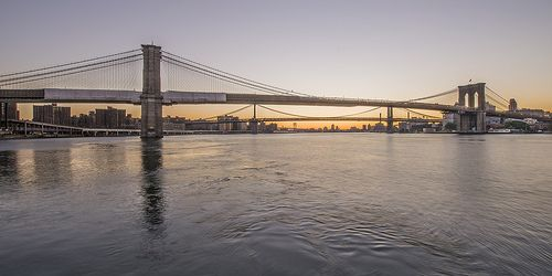 Brooklyn Bridge (closest,) Manhattan Bridge (middle) and the Williamsburg Bridge in the distance. You are seeing this as taken from the Beach Club on the South Street Seaport Pier 17.  Manhattan Island, Gotham, New York City.  I hope you enjoy the sunrise.