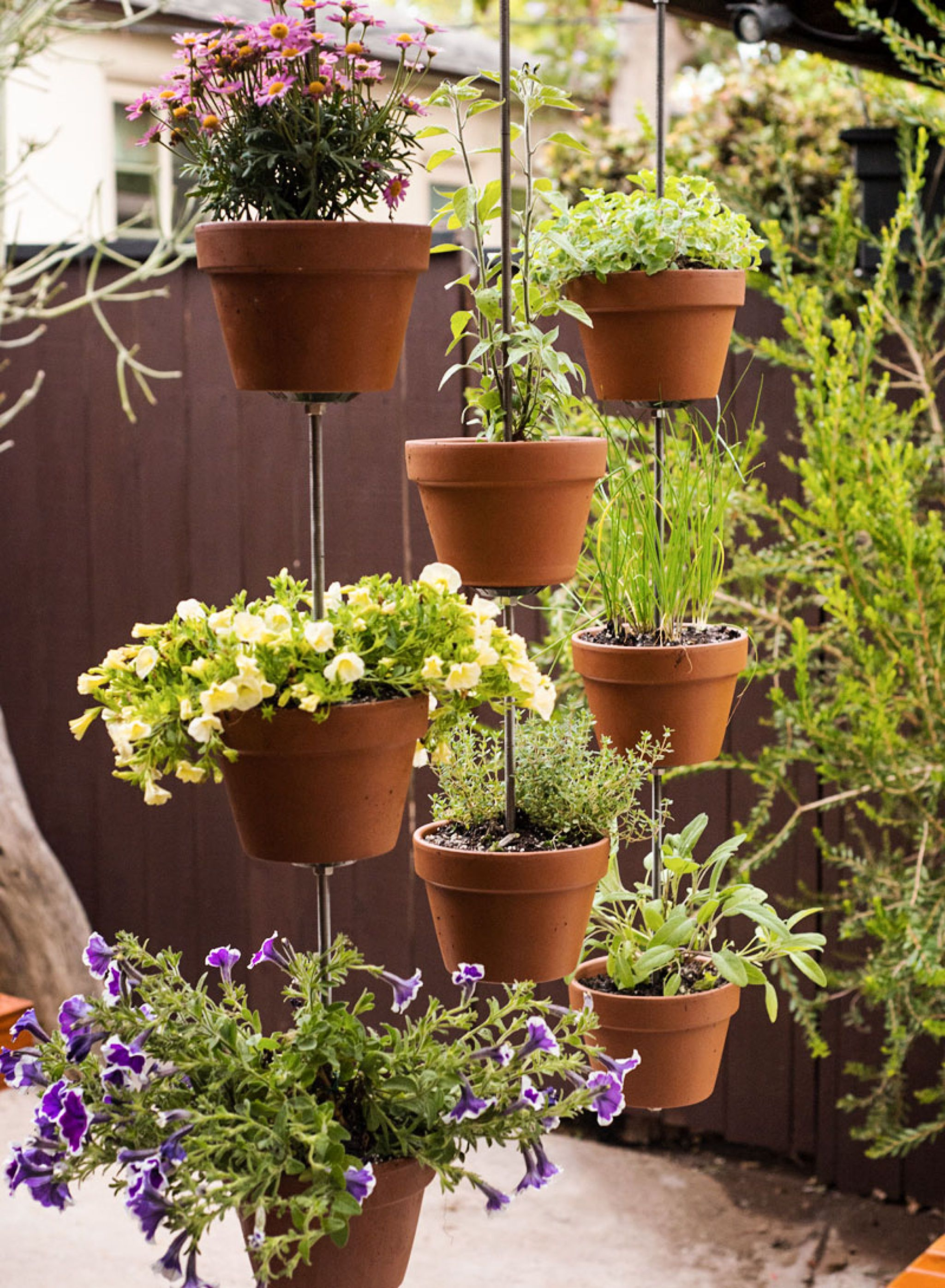 Create A Vertical Garden (privacy Screen) Using Terra Cotta Pots, Stacked  And Secured To Threaded Rods.