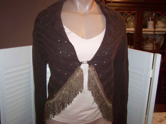 I have upcycled this brown shrug cardigan by adding this wonderful vintage fringe to the hemline.    Love the look it has now! Laying flat