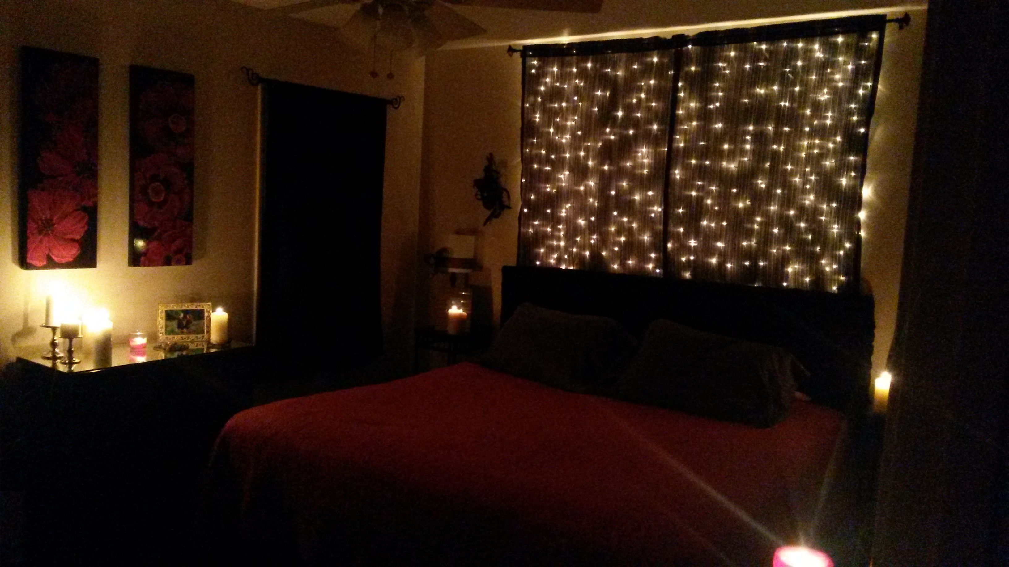Idea for over bed. Black sheer curtains and Christmas