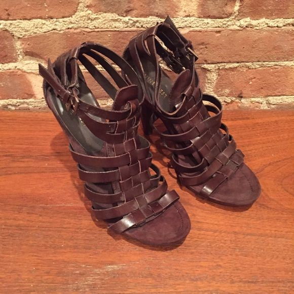 Nine West Brown Cage Sandals These Nine West brown leather strappy sandals are in excellent condition and ready to hit the town! Shoes are a size 9 and heel height is approx. 4 inches. Shoes have seen some very light wear. Nine West Shoes Heels