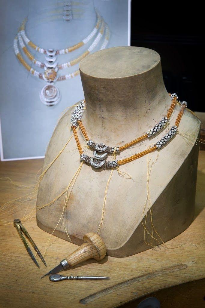 L'Odyssée de Cartier. Creation. 'Solar' necklace set with a 21.13ct cushion-shaped orange tourmaline, cabochon-cut rutilated quartz, mandarin garnet beads, brown diamond beads, obsidian and diamonds.
