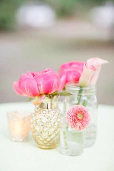 Flowers on a budget - Make the vases part of the arrangement.  Collect bud vases and use single stems in each vase.