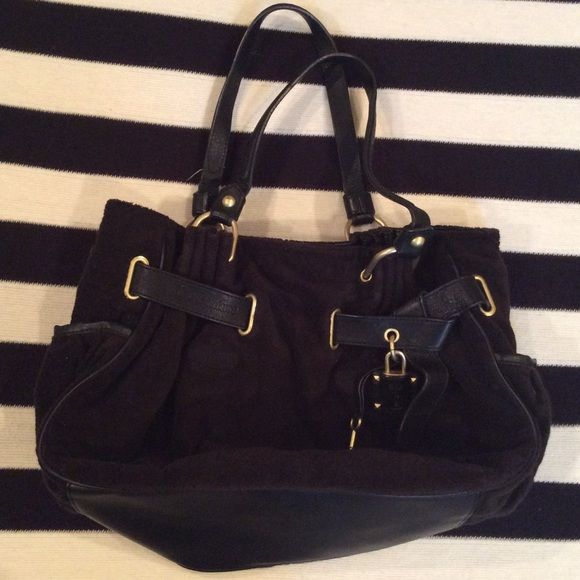 """Juicy Couture Tote Beautiful black Juicy Couture tote. Black leather and terry cloth. Inside pockets labeled """"SHOP!"""", """"Hello?"""", and """"JUICY Kiss!!"""". The bag is in like new condition, I almost hate to sell but I just haven't used it. Handle drop length is approx 10"""". 13""""h x 15"""" x 5"""". Juicy Couture Bags Totes"""